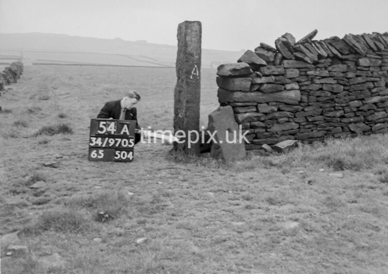 SD970554A1, Man marking Ordnance Survey minor control revision point with an arrow in 1950s