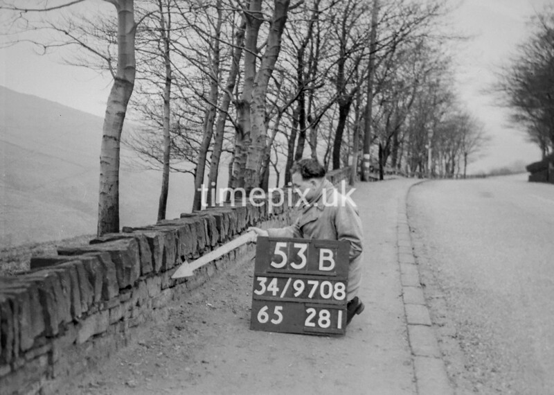 SD970853B, Man marking Ordnance Survey minor control revision point with an arrow in 1950s