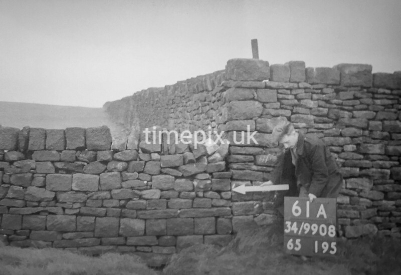 SD990861A, Man marking Ordnance Survey minor control revision point with an arrow in 1950s