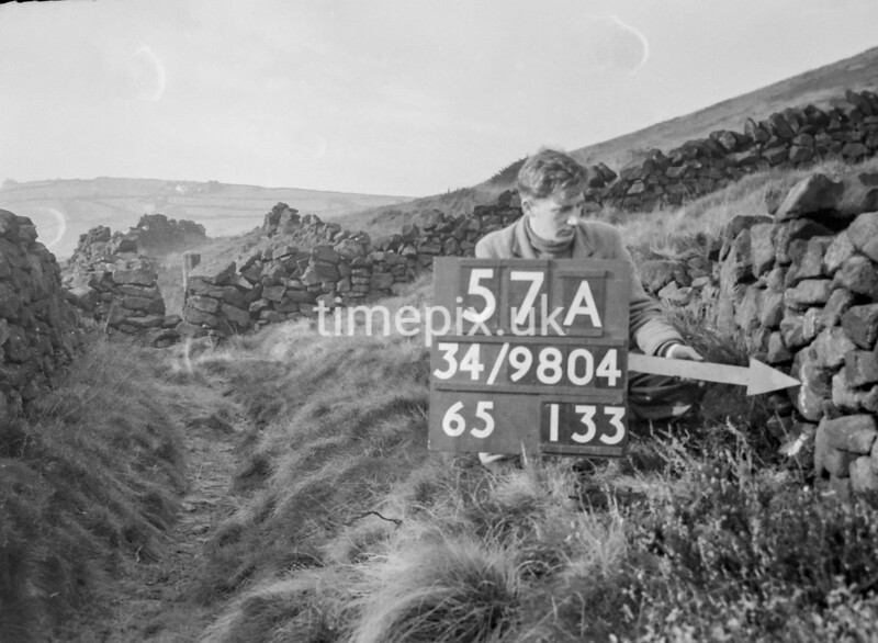 SD980457A, Man marking Ordnance Survey minor control revision point with an arrow in 1950s