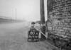 SD970780A, Man marking Ordnance Survey minor control revision point with an arrow in 1950s