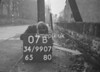 SD990707B, Man marking Ordnance Survey minor control revision point with an arrow in 1950s