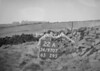 SD970722A, Man marking Ordnance Survey minor control revision point with an arrow in 1950s