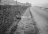 SD990793A3, Man marking Ordnance Survey minor control revision point with an arrow in 1950s