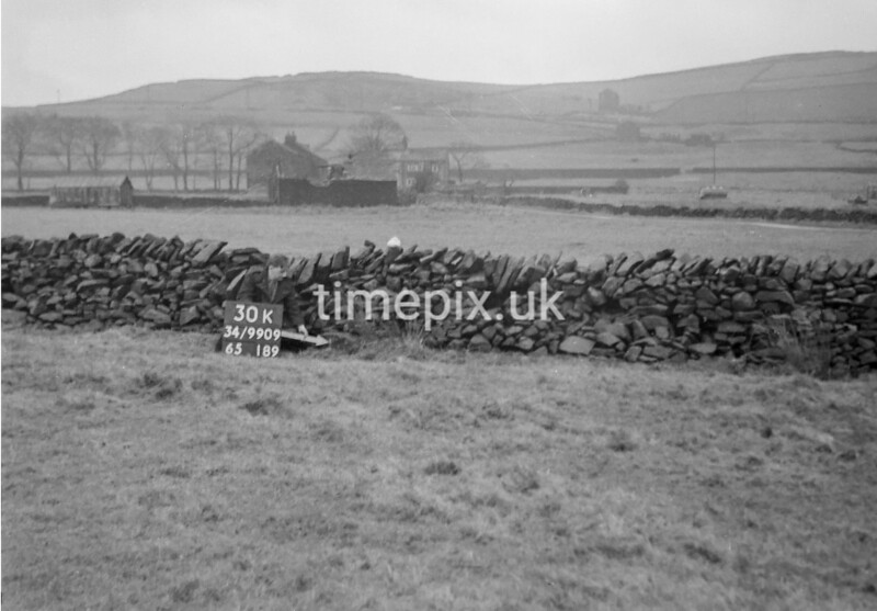 SD990930K, Man marking Ordnance Survey minor control revision point with an arrow in 1950s