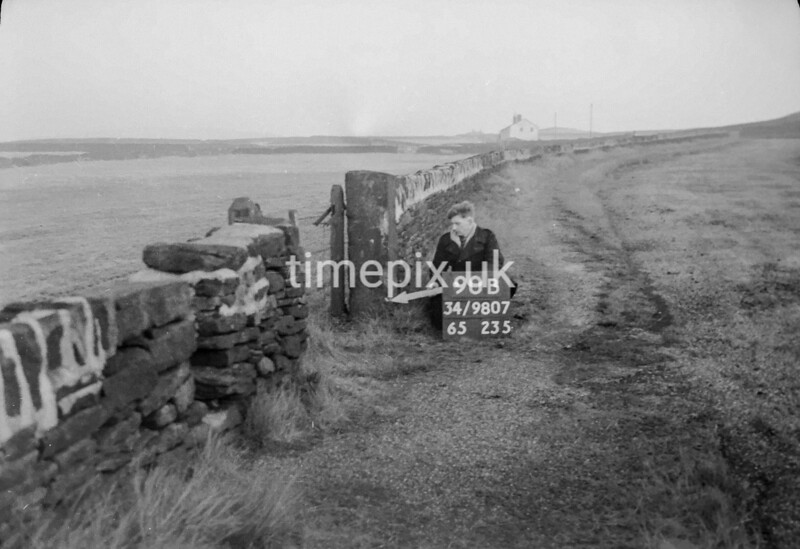 SD980790B, Man marking Ordnance Survey minor control revision point with an arrow in 1950s