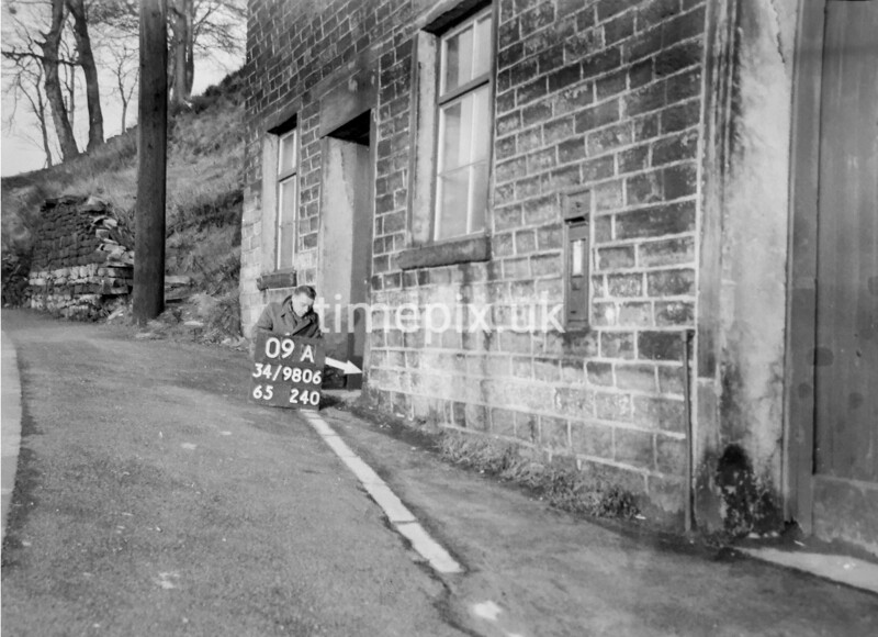 SD980609A, Man marking Ordnance Survey minor control revision point with an arrow in 1950s