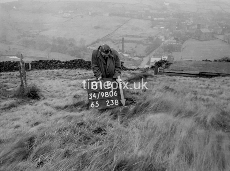 SD980681B, Man marking Ordnance Survey minor control revision point with an arrow in 1950s