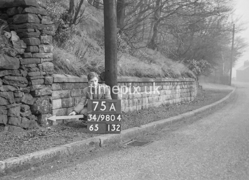 SD980475A, Man marking Ordnance Survey minor control revision point with an arrow in 1950s