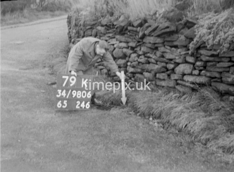 SD980679K, Man marking Ordnance Survey minor control revision point with an arrow in 1950s