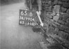SD990465B, Man marking Ordnance Survey minor control revision point with an arrow in 1950s