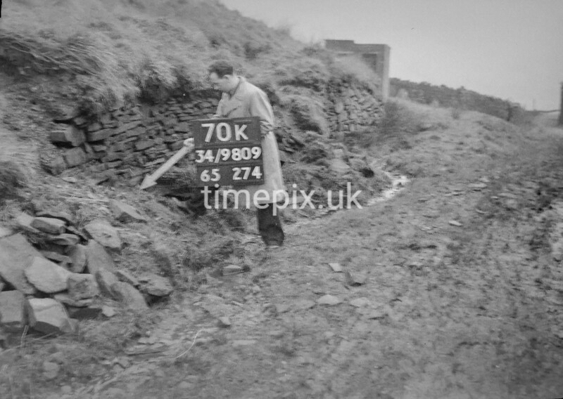 SD980970K, Man marking Ordnance Survey minor control revision point with an arrow in 1950s