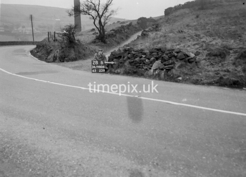 SD980628B, Man marking Ordnance Survey minor control revision point with an arrow in 1950s