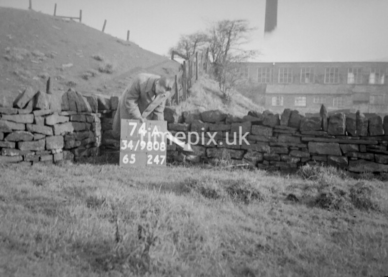 SD980874A, Man marking Ordnance Survey minor control revision point with an arrow in 1950s