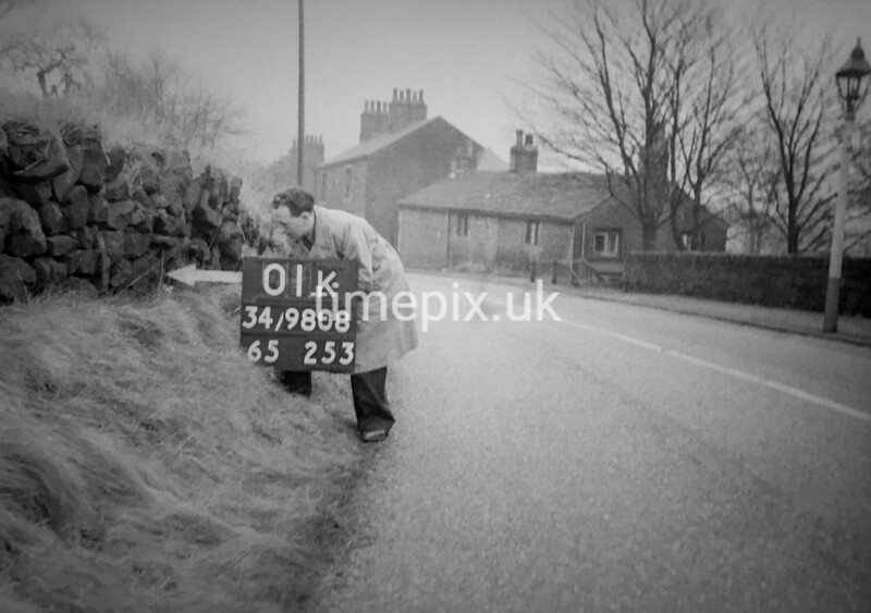 SD980801K, Man marking Ordnance Survey minor control revision point with an arrow in 1950s