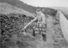 SD970718B, Man marking Ordnance Survey minor control revision point with an arrow in 1950s