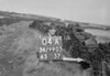 SD990504A, Man marking Ordnance Survey minor control revision point with an arrow in 1950s