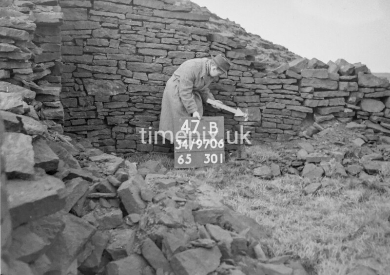 SD970647B, Man marking Ordnance Survey minor control revision point with an arrow in 1950s
