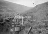 SD970740B, Man marking Ordnance Survey minor control revision point with an arrow in 1950s
