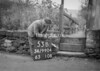 SD990453B, Man marking Ordnance Survey minor control revision point with an arrow in 1950s