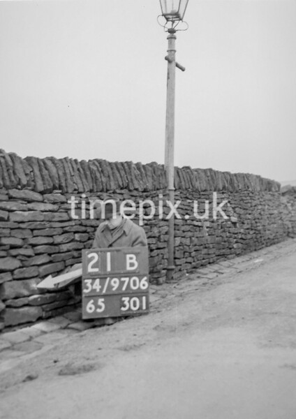 SD970621B, Man marking Ordnance Survey minor control revision point with an arrow in 1950s