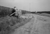 SD980523B, Man marking Ordnance Survey minor control revision point with an arrow in 1950s