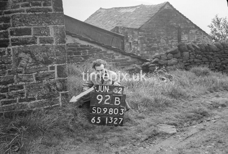 SD980392B, Man marking Ordnance Survey minor control revision point with an arrow in 1950s