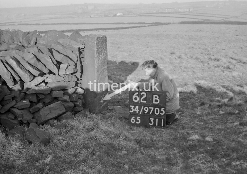 SD970562B1, Man marking Ordnance Survey minor control revision point with an arrow in 1950s