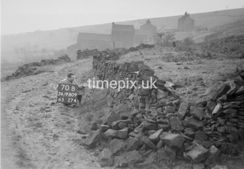 SD980970B, Man marking Ordnance Survey minor control revision point with an arrow in 1950s