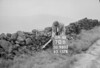 SD980370B, Man marking Ordnance Survey minor control revision point with an arrow in 1950s