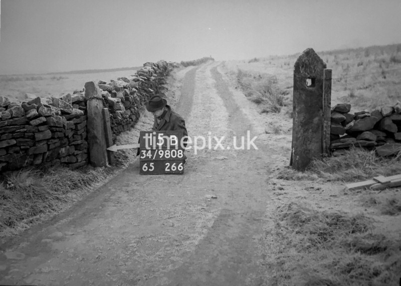 SD980815B, Man marking Ordnance Survey minor control revision point with an arrow in 1950s