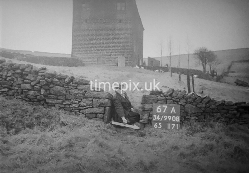 SD990867A, Man marking Ordnance Survey minor control revision point with an arrow in 1950s