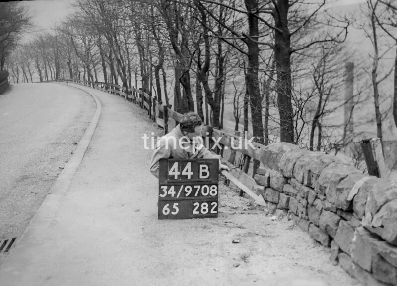 SD970844B, Man marking Ordnance Survey minor control revision point with an arrow in 1950s