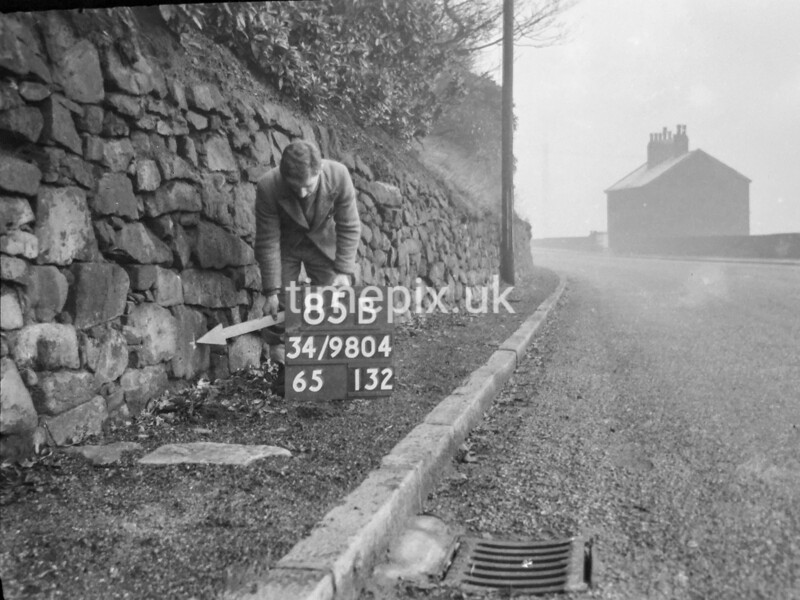 SD980485B, Man marking Ordnance Survey minor control revision point with an arrow in 1950s