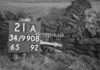 SD990821A, Man marking Ordnance Survey minor control revision point with an arrow in 1950s