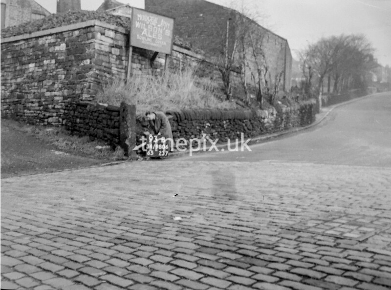 SD980693B, Man marking Ordnance Survey minor control revision point with an arrow in 1950s