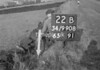 SD990822B, Man marking Ordnance Survey minor control revision point with an arrow in 1950s