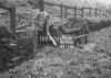SD990781A, Man marking Ordnance Survey minor control revision point with an arrow in 1950s