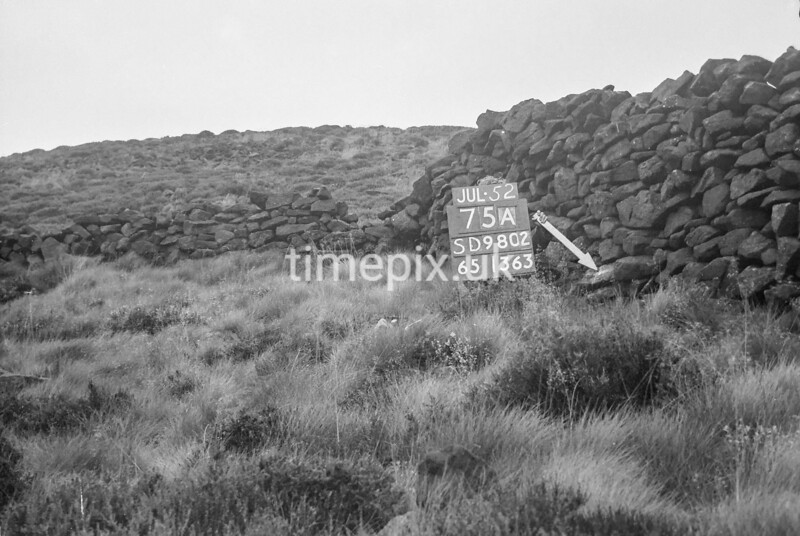 SD980275A, Man marking Ordnance Survey minor control revision point with an arrow in 1950s