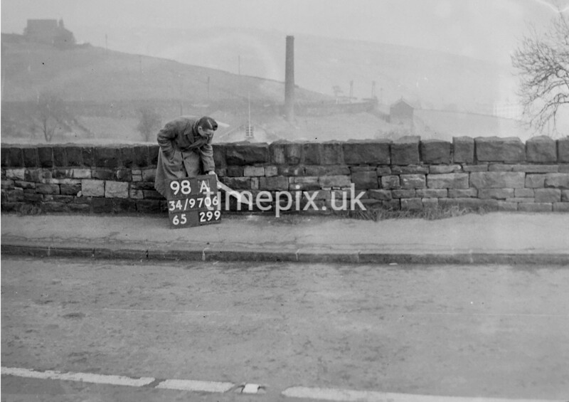 SD970698A, Man marking Ordnance Survey minor control revision point with an arrow in 1950s