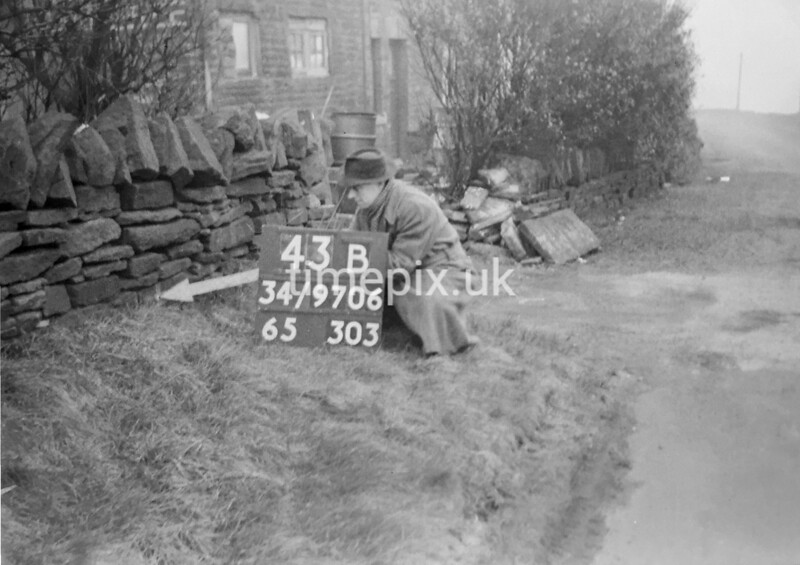 SD970643B, Man marking Ordnance Survey minor control revision point with an arrow in 1950s