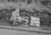 SD990663A, Man marking Ordnance Survey minor control revision point with an arrow in 1950s