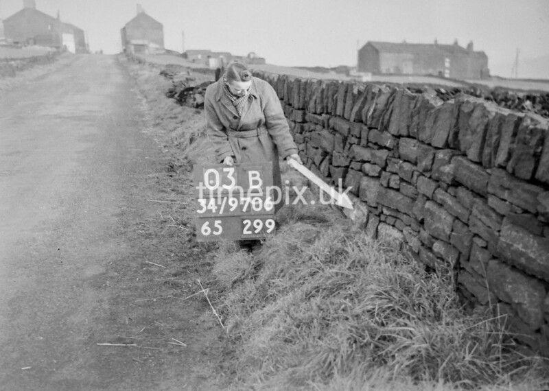 SD970603B, Man marking Ordnance Survey minor control revision point with an arrow in 1950s