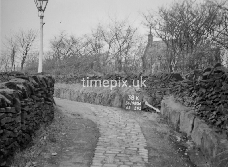 SD980638K, Man marking Ordnance Survey minor control revision point with an arrow in 1950s
