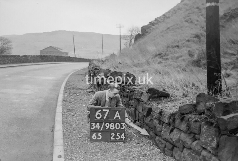 SD980367A, Man marking Ordnance Survey minor control revision point with an arrow in 1950s