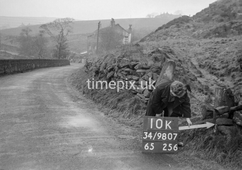SD980710K, Man marking Ordnance Survey minor control revision point with an arrow in 1950s