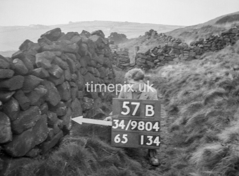 SD980457B, Man marking Ordnance Survey minor control revision point with an arrow in 1950s