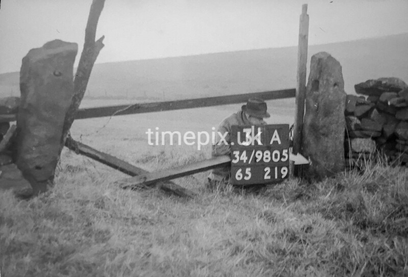 SD980531A, Man marking Ordnance Survey minor control revision point with an arrow in 1950s
