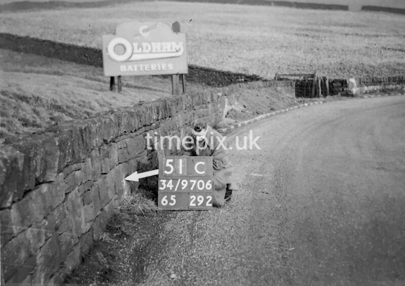 SD970651C, Man marking Ordnance Survey minor control revision point with an arrow in 1950s