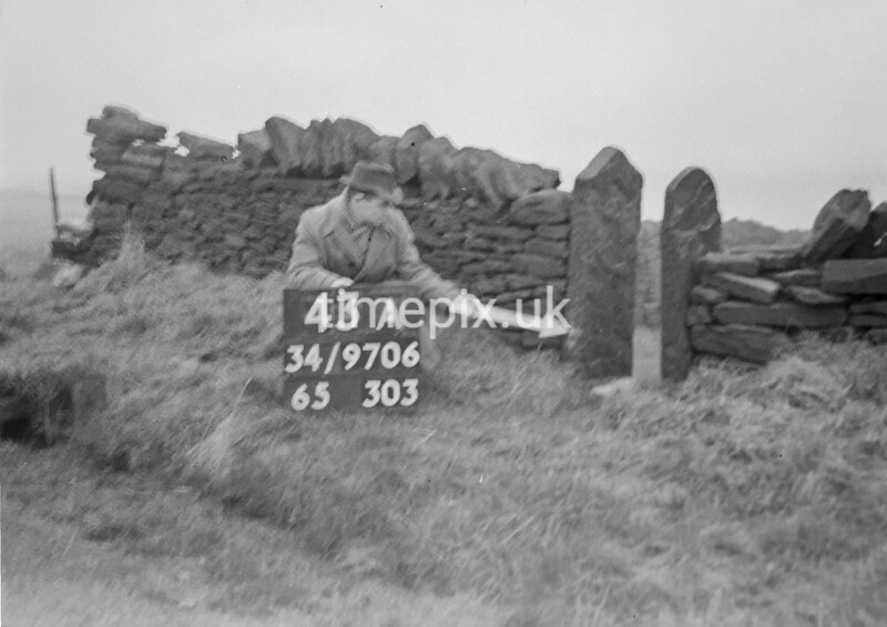 SD970643A, Man marking Ordnance Survey minor control revision point with an arrow in 1950s